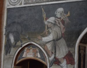 038- pastori che portano cinghiali-maiali